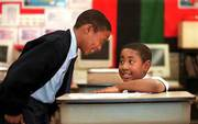 Michael Davis Jr., left, and Tyler Butler hang out in their fourth-grade classroom as they wait for Butler's mother. Davis and Butler are two voucher students at St. Adalbert School in Cleveland. A federal appeals court Monday declared Cleveland's school-voucher program unconstitutional because it uses tax money to send students to religious schools.
