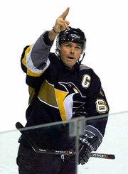 Pittsburgh's Jaromir Jagr signals to the crowd following his third goal of the game. The Penguins tied the Canadiens, 4-4, Saturday in Montreal.