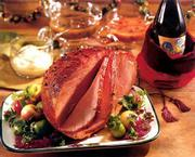 "Glazed Baked Ham is one of the rich-looking holiday foods that can also be low-fat, when prepared with a recipe in ""Betty Crocker&squot;s Best Christmas Cookbook."""