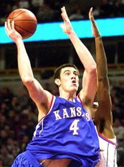 Nick Collison drives to the basket in a game against DePaul. Collison is the Big 12 men's basketball player of the week.