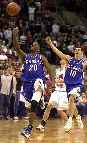 As time expires on his homecoming in Columbus, Ohio, KU's Kenny Gregory (20) tosses the ball in the air as teammate Kirk Hinrich celebrates. The Jayhawks managed a 69-68 victory over Ohio State on Saturday.