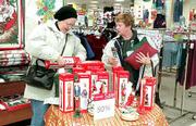 After-Christmas sales can account for as much as 15 percent of holiday sales, retail analysts say. Helping add to JC Penney's bottom line Tuesday in Lawrence were Rhetta Jo Noever, left, and Sadie Deaton.