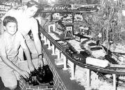 A photo from 1967 shows Phil Gaus Jr., top, and his younger brother Bob at home during the holidays with the family model train set.