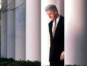 President Clinton walks to the Rose Garden podium Dec. 11, 1998, to deliver a short statement on the impeachment inquiry in Washington.