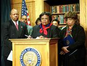 Members of the Black Caucus, Rep. Elijah Cummings, D-Md., left, Rep. Carrie Meek, D-Fla., center, and Rep. Corrine Brown, D-Fla., walked out of the ceremony on Capitol Hill in protest of the results that gave the presidential election to Texas Gov. George W. Bush over Vice President Al Gore.