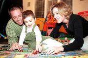 Two-year-old Miles Blomgren races cars with his parents, Dan and Jill Blomgren, recently. Miles is recovering nicely after receiving part of his father's liver in a transplant operation in November.