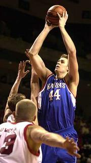 Kansas' eric Chenowith (44) shoots. Chenowith finished with eight points and six boards Saturday.