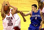 Texas Tech's Cliff Owens (13) takes a rebound to the face as KU's Nick Collison (4) looks on. Owens had 10 rebounds and Collison had 12 points and six boards Saturday in Lubbock, Texas.