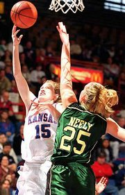 KU's Jennifer Jackson (15) shoots a layup against Baylor's Michelle Neely. The Bears won, 85-80, Saturday at Allen Fieldhouse.