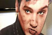 Lipstick marks cover a cardboard cutout of Elvis Presley on display at the Elvis-A-Rama Museum in Las Vegas. Presley, who would have turned 66 today, is still an icon in Las Vegas, a city that refuses to give up on the power of the King.