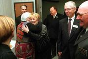 "New Kansas State Board of Education member Sue Gamble, left, gets a hug from fellow board member Janet Waugh as other board members from left, Carol Rupe, Bruce Wyatt, Steve Abrams, Harold L. Voth and I.B. ""Sonny"" Rundell watch. The greeting took place after two new and three re-elected board members were sworn in Tuesday at the Department of Education building in Topeka."