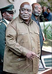 President of the Democratic Republic of the Congo, Laurent Kabila leaves the Elephant Hills Hotel in Zimbabwean resort town of Victoria Falls on Aug. 8, 1998.