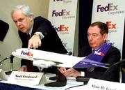 FedEx is delivering a big contract to Europe-based Air France. Tuesday, Fedex Chairman and Chief Executive Officer Frederick Smith, left, announced FedEx would buy 10 Airbus A380 airplanes in a multibillion-dollar deal. Here, Smith notes his company's logo on aa A380 model during a meeting at the National Press Club in Washington. Airbus Chairman Noel Forgeard is at right.