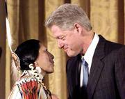 President Clinton congratulates Rose Anne Abrahamson, a member of the Lemhi Shoshone tribe and descendent of Sacagawea's brother Cameahwait, during a White House event commemorating the efforts of explorers Lewis and Clark.