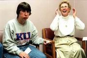 Meredith Leary, left, and her mother, Norma Leary, react to news that the date for the first of three brain surgeries at the Kansas University Medical Center has been moved up, and they have only one day to prepare for a possible three-week hospital stay. Meredith, 38, heard the news shortly after having a mild seizure that evoked involuntary crying and left her face flushed.