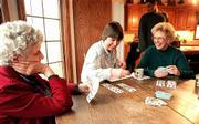 On thanksgiving Day with her family gathered at her parents' home, Meredith enjoys Liverpool rummy, her favorite card game, with her grandmother, Dorothy Leary, left, and her mother, Norma. Meredith always keeps score and hates to lose.