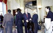President Bush and wife Laura greet the first visitors to the Bush administration White House, in the main foyer during the traditional open house, Sunday, Jan. 21, 2001.