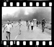 South Vietnamese forces follow terrified children, including 9-year-old Phan Thi Kim Phuc, center, as they run down Route 1 near Trang Bang, Vietnam, after an aerial napalm attack on June 8, 1972. A Vietnamese Air Force bomber accidentally dropped its flaming napalm on South Vietnamese troops and civilians. The terrified girl had ripped off her burning clothes while fleeing.
