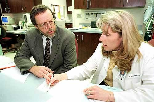 Photo: Dr. Matt Stein reviews patient treatments with oncology ...