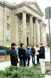 Students from Kanagawa University in Hiratsuka, Japan, take a tour of the Kansas University campus. The 11 members of the group, which arrived Sunday, will be living in Lawrence for a month for an exchange program between the sister cities.