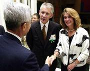 Gov. Bill Graves, center, and Kansas first lady Linda Graves greet guests at a September reception at U.S. Ambassador to Japan Thomas Foley's residence in Tokyo. The governor has proposed amending Kansas campaign finance law so that he can use campaign funds for his wife's political trips.