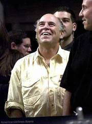 Singer Jimmy Buffett laughs as fans cheer as he stands at the end of the tunnel overlooking the final minutes of overtime play between the New York Knicks and the Miami Heat Sunday Feb. 4, 2001 at the American Airlines Arena in Miami. Referee Joe Forte ejected Buffett from his seat along the baseline for using profanity.
