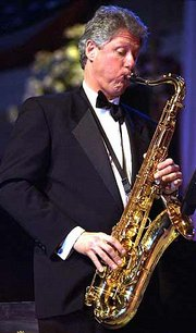 President Clinton plays the saxophone during the presidential inaugural ball at the National Building Museum in Washington in this Jan. 21, 1993, file photo. A report in Italian media helped fuel a rumor during the weekend that the former president had been invited to play at Italy's San Remo Music Festival. The president was only asked to speak at the festival, and has rejected the offer.