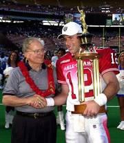 AFC QUARTERBACK RICH GANNON, right, holds the Pro Bowl most valuable player trophy, which was presented by Kansas City Chiefs owner Lamar Hunt, left, on Sunday in Honolulu. Gannon, now with Oakland, is a former Chief.