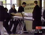 In this image from television, security officials take a suspected gunman into the emergency room of the George Washington University Hospital, in Washington, Wednesday, Feb. 7, 2001. A Secret Service officer shot a man with a gun outside the White House on Wednesday, officials said. President Bush was reported safe inside the residence.