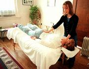 Using hand positioning designed to relieve stress and anxiety, Marta A. Schwartz performs the ancient Japanese healing method of Reiki on Renee Quint. Schwartz is a Reiki master and has practiced the Usui system of Reiki since 1997.