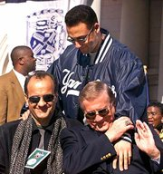 New York shortstop Derek Jeter, rear, greets Yankee manager Joe Torre, left, and owner George Steinbrenner at the start of a rally at City Hall on Oct. 29, 1999. Jeter and the Yankees agreed to a 10-year, $189 million contract Friday.