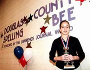 Sarah Elbayoumy takes the Douglas County Spelling Bee trophy home to Southwest Junior High School. The eighth-grader outlasted and outspelled 26 other competitors Saturday in the contest sponsored by the Lawrence Journal-World, and will advance to competition in Topeka.
