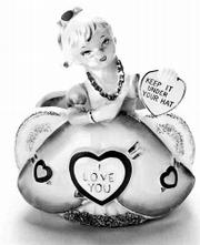 """This 5 3/4-inch-high valentine lady with the message """"Keep it under your hat, I love you"""" is marked with the """"R"""" of Rubens Originals. It was made in the 1960s. A flea-market find, it cost only $15."""