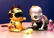 Meow-Chi, left, and Robo Baby from Hasbro Inc.'s Tiger Electronics are part of a new generation of electronic pets making its official debut at the American International Toy Fair. These toys make last year's popular models look like windup toys.