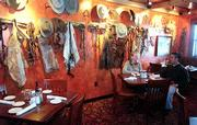 The extensive and unique collection of western art and artifacts contributes to the Hereford House atmosphere. The Tack Room dining area features a wall of chaps and boot spurs.