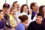 Wisconsin Gov. Scott McCallum and his wife, Laurie, applaud during a recent basketball game at James Madison Memorial High School in Madison, Wis. The McCallums' son, Rory, plays for James Madison. Also shown are the couple's other children, Cara, 13, in light-colored shirt, and Zachary, 18, bottom right. The McCallums are members of the Christian Scientist church.