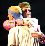 Elton John and Eminem embrace at the conclusion of their duet Wednesday at the 43rd annual Grammy Awards in Los Angeles.