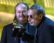 "Steely Dan founders Walter Becker, left, and Donald Fagen accept the Grammy for best pop vocal album for ""Two Against Nature."" Steely Dan also won album of the year.v"