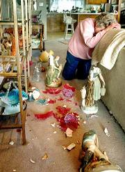 Vivian Crow of Rocky Point, Wash., reacts to the destruction of nearly every treasure in her home after an earthquake rocked the Puget Sound area. Porcelain figurines, collectible glass objects, Tiffany stained glass, and more lay broken and shattered in the two-story home.