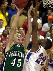 Free State's Pat Krivoshia (45) scores over Leavenworth's Shawn Rodgers. Free State won Thursday night at Lawrence High.