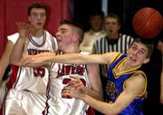 Lawrence High's D.J. Watkins battles Olathe South's Trey O'Dell for the ball. The Lions won, 66-53, in a sub-state semifinal Thursday night at the LHS gym.