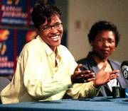 Lynette Woodard, left, announces her retirement from the WNBA in this May 27, 1999, file photo. Woodard and Kansas coach Marian Washington, right, want the NCAA to include AIAW records in the college record books.