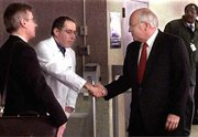 Vice President Dick Cheney shakes hands with his physician Tuesday as he leaves George Washington University Hospital in Washington.