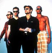 Some fans of the rock group U2 are concerned about safety in the wake of an announcement of an open seating policy for the group's May concerts in Chicago. At other groups' concerts with open seating, fans have been trampled to death. In this April 1997 file photo, members of U2 pose for a portrait. From left, are guitarist The Edge, drummer Larry Mullen Jr., lead vocalist Bono and bass player Adam Clayton.