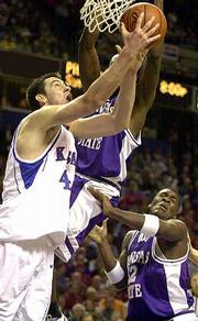 Nick Collison drives the baseline on Kansas State's Kelvin Howell. Collison had 11 points Friday at Kemper Arena.