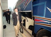 "Kansas University Men&squot;s basketball player Brett Ballard boards a bus bound for Topeka&squot;s Forbes Field as the team begins its trek to the NCAA Midwest Regional in Dayton, Ohio. After a dinner Wednesday at Allen Fieldhouse, the team left with little fanfare. Also pictured are, from back, Todd Kappelmann and Drew Gooden. See <a href=""http://www.ljworld.com/section/tourney"" target= ""new"">kusports.com.</a>"