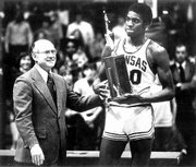 Former KU player Norm Cook, seen receiving his Big Eight Conference Freshman of the Year Award from Chancellor Archie Dykes, has a son on Illinois' basketball team.