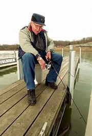 Testing his luck, Clarence White, Lawrence, enjoyed the afternoon Wednesday at Clinton Lake trying to catch some crappie.