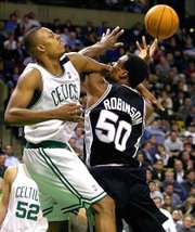Boston's Paul Pierce, left, knocks the ball from San Antonio's David Robinson. The Spurs defeated the Celtics, 97-77, Wednesday night in Boston.