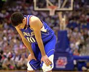 Kansas guard kirk hinrich reacts during the Jayhawks' loss to Illinois. KU's season ended with an 80-64 setback in the Midwest Regional semifinals on Friday in San Antonio.